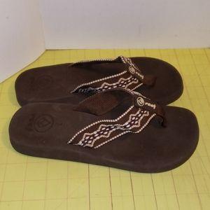 Reef Brown flip flops